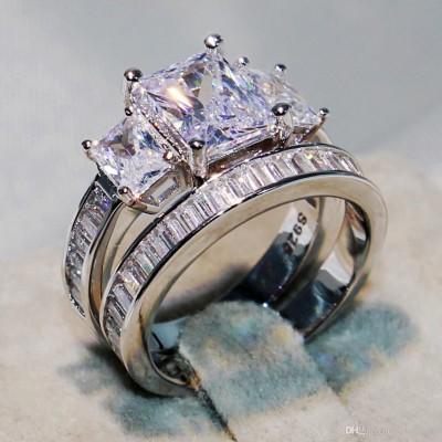 Emerald Cut White Sapphire Three-Stone Bridal Sets